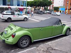 Your eyes are not deceiving you, you are actually looking at a lime green, convertible, stretch slug bug.