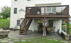>> Have a look at Patio beneath deck with separate firepit patio
