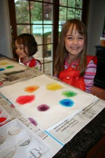 Montessori lesson with colored water and waxed paper