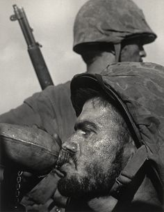 W. Eugene-Smith, American (1918–1978). Frontline Soldiers with Canteen, 1944
