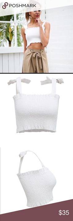 Summer '18 You'll love this white tube top with ruffles on top and bottom // ties on each side at shoulder to make cute bows // made of polyester, cotton, viscose // hand wash recommended // new boutique item in package // imported // size 4-6 fits small; size 8-10 fits medium; size 12 fits large // specific measurements available upon request // bundle & save Tops Crop Tops