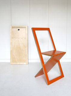 Fold Up Chair, Pallet Wood and Vinyl Decals to compliment the sleek modern design.