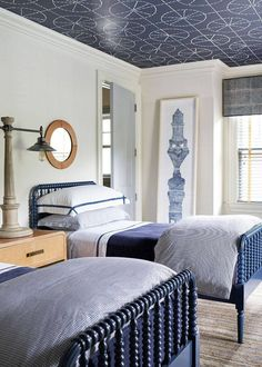 This Home Proves Updated Traditional Is Here to Stay - pretty blue and white bedroom with cool wallpaper on the ceiling
