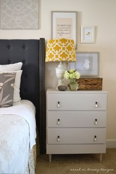 sarah m. dorsey designs: beautiful nightstand vignette (also some great DIY instructions on the art over the bed and, in another post, how to make the tufted headboard).