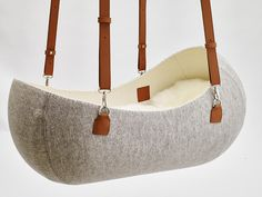 A Hanging Felt Cradle Inspired by the Womb - Design Milk