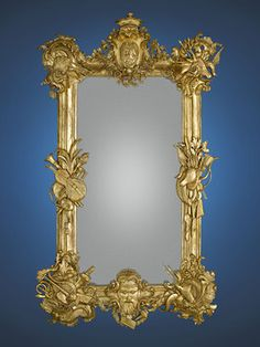 """Copiously carved musical and hunting elements charaterize this superior 19th-century French gilt wood mirror. The motif bears a bearded mask at the base and a crest atop, featuring a lion rampant surmounted by a crown, characteristic of the coats-of-arms of nobility. This beautiful mirror is further distinguished by its retention of its original silvered glass. Circa 188029 1/2"""" wide x 53 1/8"""" high"""