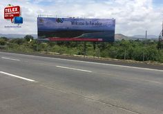 Kesari Tour & Travels campaign done by Telex advertising, hoarding at Mumbai pune express highway.