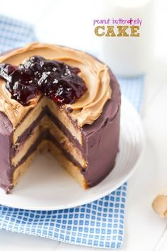 Peanut Butter and Jelly Cake recipe.  This Peanut Butter and Jelly Cake is perfect for the PB&J lover in your life! It's pretty, nostalgic, and full of flavor!