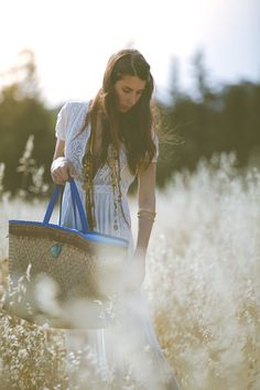The Indiana straw beach bag with electric blue leather handles and trims, combined with light blue stripe lining in the interior. It is adorned with brown lace and with a gold toned pendant on the front. This straw bag is perfect for your vacation getaways and city escapes. Calling all the beach lovers! #beachbag #strawbag #strawbeachbag #beach tote #beachstrawbag #strawtote #resort #accessories #summer #holidays #heatwave #islandlife #leather #bags #style #dDbyDaniellaGeorgiou Leather Handle, Leather Bags, Straw Tote, Electric Blue, Gold Pendant, Blue Stripes, Light Blue, Beach Bags, Brown