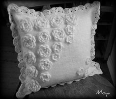Knitted cushion cover with crochet roses