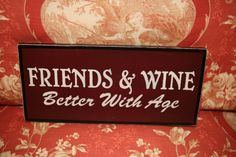 A Hand Painted Distressed Wood Wine Sign