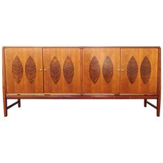 Custom American Modernist 1960s Teak and Rosewood Credenza | From a unique collection of antique and modern credenzas at https://www.1stdibs.com/furniture/storage-case-pieces/credenzas/