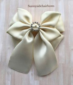 hair bows Beautiful specially handcrafted hair bow for brides, bridesmaids or flower girls. This boutique style stacked bow is made from double sided soft Ivory satin ribbon, a circle of rhi Flower Hair Bows, Flower Hair Accessories, Flower Girls, Satin Bows, Ribbon Bows, School Hair Bows, Black Hair Bows, Girl Hair Dos, Bow Wedding