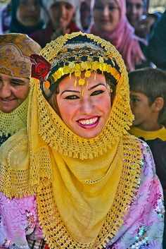 Syria |  Portrait of a beautiful girl wearing a chador in the village of Apamea