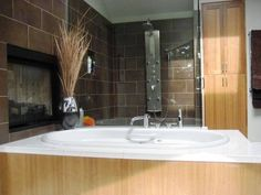 Fireplace and soaking tub in the master bath -- 11607 72ND PLACE, KIRKLAND