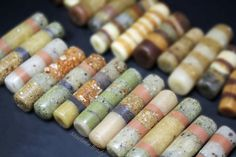 Marlene Brady: Polymer Clay Inclusion Beads. The various effects are made by mixing in spices, embossing powders, glitters, and all sorts of creative fine and granular substances prior to baking.