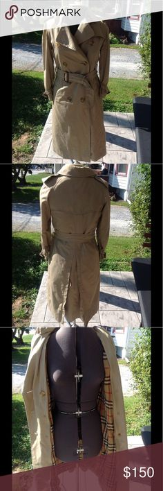 Womans vintage burberrys trench coat. It is a size small, tan it is vintage, burberrys is older, Burberry is newer, has some slight stains on the bottoms of sleeves, the wooden buckle is a little worn on the left side at the bottom of the arm, in great worn condition. Burberry Jackets & Coats Trench Coats