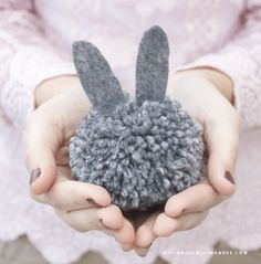 DIY Pom Pom Bunny Garland - Designs By Miss Mandee. Such a simple, inexpensive craft, but SO cute! FREE pom pom maker template included. This would be a fun one to make with kids.