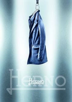 Techno Coat  Versatile and sophisticated short raincoat in a rainproof opaque fabric. The cotton details in contrast on the removable bib give this classical piece a fierce touch.   Double fastening with buttons and double slide zipper Slim fit https://www.facebook.com/HernoSpa/photos/a.864272053589406.1073741834.139235326093086/896156080401003/?type=3theater
