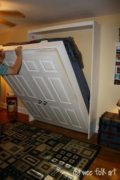 Take a old door and turn it into a hide-a-way bed. - I like the idea of using a set of old doors - CJ Cama Murphy, Murphy Bed Ikea, Murphy Bed Plans, Hidden Bed, Decorate Your Room, Old Doors, Spare Room, Basement Remodeling, Basement Ideas