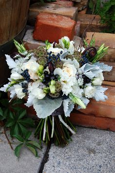 Beautiful bouquet of dusty miller, fiddle fern, queen anne's lace, roses, spray roses, freesia, lisianthus, birch branches, scabiosa pods, silver brunia, ornamental black pepper, and viburnum berries.