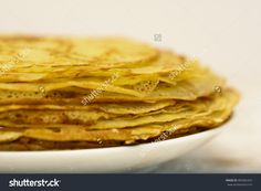 Pancakes with oil. Traditional Russian pancakes. Stock photography, images, pictures, Illustrations, ideas. Download vector illustrations and photos on Shutterstock, Istockphoto, Fotolia, Adobe, Dreamstime.