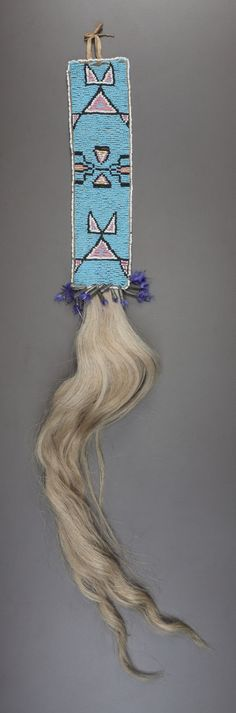 A SIOUX BEADED HIDE HAIR DROP. c. 1890... American Indian Art | Lot #50308 | Heritage Auctions