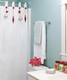 Lowe's Home Improvement Quick Tip: Add a touch of holiday to the guest bath by hanging coordinating Christmas ornaments on the shower curtain hooks!