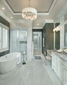 Stunning new bathroom with free standing tub and walk in shower in Liberty Township Luxury Designer Home. See more of this model's pics at http://arhomes.us/ohiomodelhome1 #Contemporarybathrooms #ModernLuxuryBedding