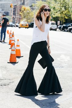 """The Year in Tommy Ton  Jayne Min """"It takes confidence and whimsy to pull off bell bottoms, especially during fashion week. Jayne loves a rare runway piece; her Ellery trousers swept away all the fashion week posers."""""""