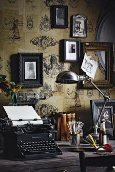Vintage wallpaper coupled with gorgeous old typewriter and salon style hung art make for an office or workspace worthy of any writer! #interiordesign #homedecor
