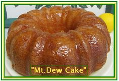 """""""Mt.Dew Cake""""---------------------------------------------------------------------------- Cake: 1 box yellow cake mix, 1 Lg. Box vanilla pudding, 8 oz Mountain Dew(1 cup), 4 eggs, 1/2 c. water, 1/2 c. oil ---------------------Spray pan with pam. Mix everything together and pour into a bundt cake pan (or u can use a 9x13). Bake for approx. 1 hour at 350 degrees.------------------------------------------------------------------------------------------------- Glaze Icing: 1 cup sugar, 1 stick…"""