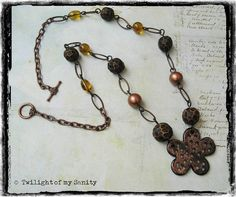 Long brown necklace wirh simple flower pendant and handmade golden brown faceted beads by TwilightOfMySanity, €21.00