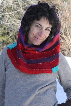 Snuggly. Warm. Guaranteed Cozy. Bits n pieces of bright red, purple and a splash of turquoise cashmere come together in this Cashmere Cowl. Pull it right up over your head and wear it as a hood or bunch it up under your chinny chin chin and keep yourself warm and fashionable all day long. It measures 18 across and is 15 high. My new favorite garment. Stay warm, positive, smile and know that by supporting recycling and recyclers you are helping to change the world for the better. Check...