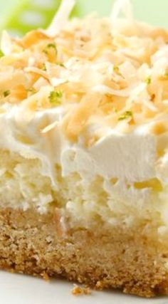 """Lime in the Coconut"" Frosted Cheesecake Bars ~ This delectable dessert bar is stacked with three scrumptious layers: a sugar cookie crust, a rich cream cheese layer and an irresistible topping of toasted coconut and grated lime peel. Cookie Desserts, Just Desserts, Cookie Recipes, Delicious Desserts, Dessert Recipes, Lime Desserts, Bar Recipes, Plated Desserts, Recipies"