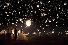 Light up the night sky with a lantern release.Related: 75 New Must-Have Photos with Your Groom