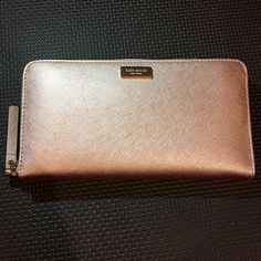 NWT Kate Spade Rose Gold Wallet New with tags 14k Gold Plated Accents Zippered Closure Exterior Slide Pocket 2 Interior Slide Pockets Interior Zippered Divider Pocket White with Black Crosshatch Interior 12 Credit Card Pockets kate spade Bags Wallets