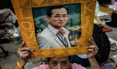 Anxious prayers for ailing Thai king outside…