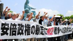 Protesters at Nagasaki Peace Park on June 9 oppose Prime Minister Shinzo Abe's plan to reinterpret the Constitution to allow Japan to exercise the right to collective self-defense.