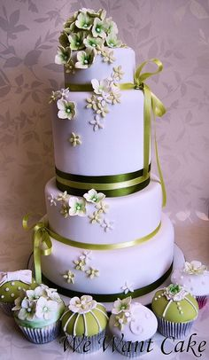 Wedding Cake with ribbon and sugar flowers and mini cupcakes