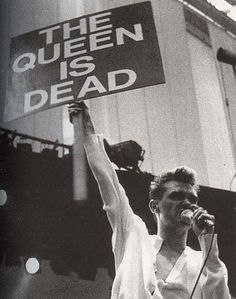 Morrissey holding 'The Queen Is Dead' sign