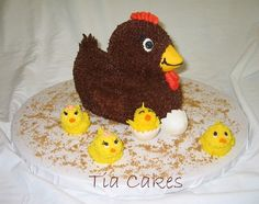 Mommy Hen with Her Chicks - I made this cake for my mom for Mother's Day.  The four chicks are her kids. : )  The hen is made with the Wilton Ducky pan.  The chicks are made out of fondant and covered in buttercream.