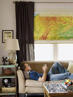 What do you think of this custom window shade made from an old school map? I think it would be perfect not just for a laid-back room like this one but also in a kid's room! #HGTV #HGTVMagazine