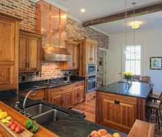 heart pine cabinets, soap stone counter tops and a brick wall- it was country before country was cool.