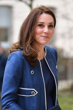 Pregnancy glow: Kate kept her makeup to a minimum. What Kate is wearing today Feb 27 2018.  Jenny Packham, blue empire waist maternity dress with matching blue cardigan style coat with white piping.