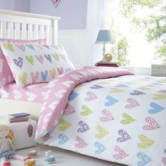 Brighten up your little kid's bedroom with this pretty heart printed duvet cover from bluezoo. It is cotton rich with a pink heart printed reverse and is complete with a matching pillow case.