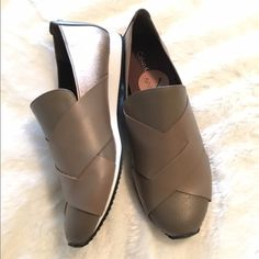 Calvin Klein Taupe Fox Slip Sneakers NWOB Gorgeous Calvin Klein taupe slip on sneakers. 70% leather, 30% elastic. Front crisscross overlay with elastic side goring panels. Super comfy with cushioned insole. Brand new without tags or box. Labeled size 7.5 but they run 1/2 size small so I'm listing as a 7. ❌ NO TRADES ❌ NO LOWBALLING ❌ Calvin Klein Shoes Sneakers