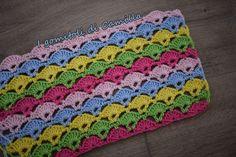 Punto ventaglietti colorati. Occorrente: cotone cablè 5 nei colori fucsia, rosa, verde, giallo e celeste, un uncinetto numero 1,75.