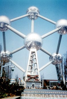 Atomium in Brussels constructed for Expo 58, the 1958 Brussels World's Fair.  It stands 335 feet tall.  It's nine stainless steel spheres are 59 feet in diameter and are connected so that the whole forms the shape of a unit cell.  It is a museum now.