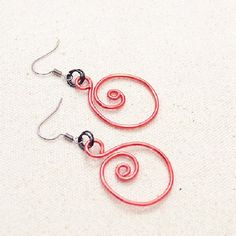 This tutorial will teach you a simple way to make distinctive Chinese red spiral earrings with aluminum wire.